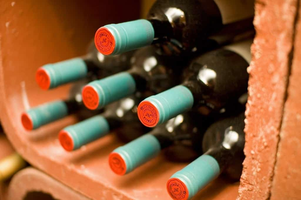 When you leave your bottles randomly stacked around your house, it's difficult to know how many bottles you own until you see them all in one place. This is why organization is important for beginning wine collectors hoping to get serious about wine. Photo Credit: Flickr CC user Stewart Butterfield