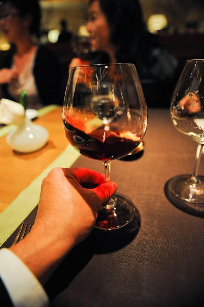 Taste-test a wine at a restaurant