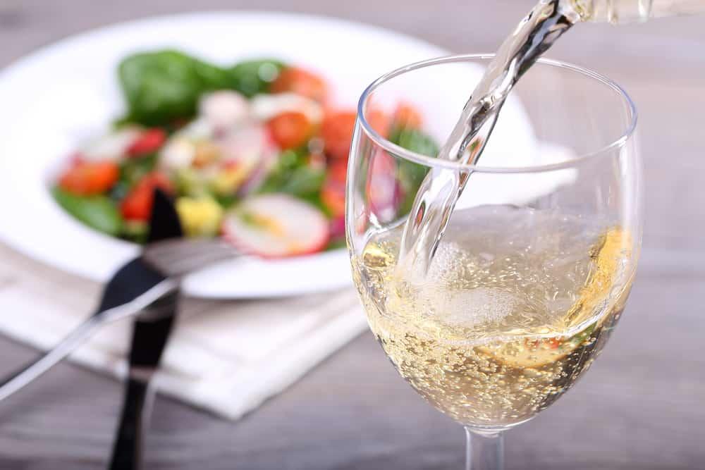 Glass of white wine displays wine pairings for vegetarians and vegans